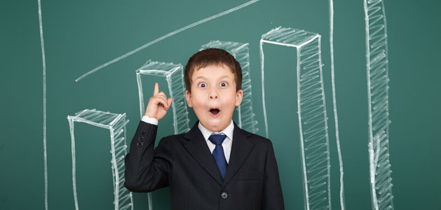 image of student in front of chalkboard bar graph