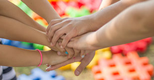 image of student hands together for a go team