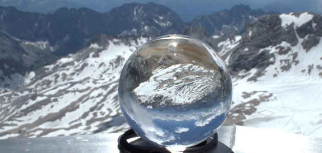 image of clear snowglobe in front of alpine habitat