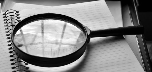 image of magnifying glass on notebook